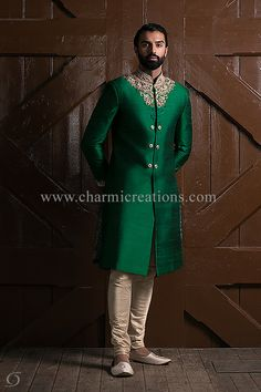 Emerald green raw silk traditional groom's sherwani with gold and antique gold embroidery. This Menswear suit will be ideal for an Indian wedding or sangeet. It comes with churidaar trousers and matching embroidered shoes. Available in different colours. Asian Wedding Dress, Wedding Dress Men, Wedding Suits, Trendy Wedding, Wedding Blog, Wedding Ideas, Indian Wedding Clothes For Men, Indian Wedding Outfits, Sherwani Groom