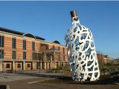 """The Bottle of Notes"" Claes Oldenburg com in 1988 installed in 1993. The building in the back is the Middlesbrough Law Courts (UK) this photo is from the site www.oldgreyheron.com Steel painted with polyurethane enamel 30 x 16 x 10 ft. (9.1 x 4.9 x 3.1 m)"