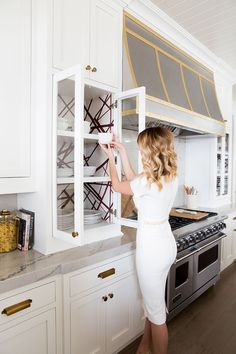 Cabinet color is Benjamin Moore White Dove. Love the geometric paper inside the cabinets. Cabinet color is Benjamin Moore White Dove. Love the geometric paper inside the cabinets. Living Room Paint, Living Room Interior, Home Interior, Living Rooms, Glass Kitchen Cabinet Doors, White Kitchen Cabinets, Glass Door, Inside Cabinets, Glass Cabinets