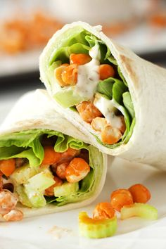 Buffalo Chickpea Wraps: Easy Vegan Lunch Idea! You can meal prep these insanely flavorful wraps ahead of time in about 20 minutes. #karissasvegankitchen #veganlunch #veganmealprep