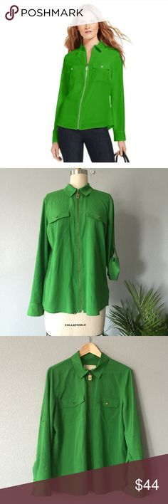Michael Kors blouse NWOT Michael Kors Top, Long-Sleeve Zip-Front Work Shirt.  MK Classic piece with a fresh Look. 100% Polyester, Cold wash  ✅ will bundle 👌🏼✅🚭 ✅ all reasonable offers will be considered 👍🏼 🚫No Trading 🙅🏻 Poshmark rules only‼️ 📝Measurements taken laying flat                            ⓂChest 22 Ⓜ️length 25  Ⓜ️ shoulders 17 Michael Kors Tops Blouses