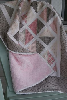 Large half square triangles with sashing. Simple, but darling baby quilt! Love pink and gray!