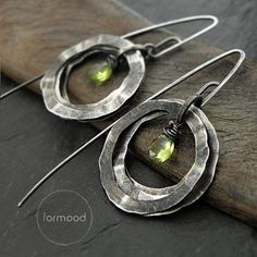 Totally handmade earrings from the collection 00 are made of silver 925 and peridots or blue topaz faceted briolettes.  Dimensions: Hammered