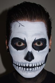 A step by step tutorial on how to do skull face paint for Halloween.