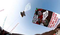 Jättipallot lennättivät Pohjois-Koreaan dollareita ja Wikipediaa - katso kuvat