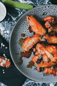 Classic Frank's hot sauce brings a dash of spice and delivers a hint of vinegar to these buffalo wings, paired with a creamy garlic and blue cheese sauce. Wing Recipes, Meat Recipes, Chicken Recipes, Potluck Recipes, Buffalo Wings, Blue Cheese Sauce, Aussie Food, Healthy Summer Recipes, Recipe For Mom