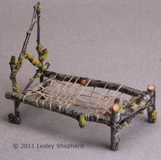 Woven mattress support in a miniature bed made from twigs #miniaturefairygardens