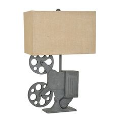 This lamp is so unique! I am a big fan of the wheels on the side—those look like a vintage camera. This kind of lamp would go perfect in our movie theater room! We'll have to find a place that we could get it from.