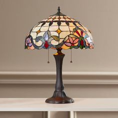 Features:  -333 Pieces glass cut.  -33 Cabochons.  -Indoor setting.  -Downlight.  -Comes with pull chain switches.  -only assembly required is putting on the lamp shade.  Fixture Finish: -Antique bron                                                                                                                                                                                 More
