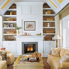 fireplace mantle ideas...build a mantle/shelves in FRONT of a huge brick wall (four generations one roof)