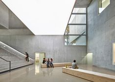 Paint was thrown at the walls of this concrete music, dance and drama school in France by Dominique Coulon & Associés, in a style like Jackson Pollock