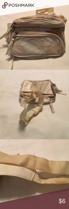Tan patchwork Fannie pack Tan pleather patchwork Fannie pack with various compartments.  Some discoloration on waist strap (displayed in picture). Bags