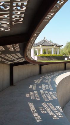 Sunlight shines through laser-cut phrases at the Moving Memories Memorial in Phoenix. The phrases are meant to reflect a range of thoughts from Arizonans affected by the idea for beliefs and values in a school environment Environmental Graphic Design, Environmental Graphics, Wayfinding Signage, Signage Design, Urban Landscape, Landscape Design, Garden Design, Landscape Architecture, Architecture Design