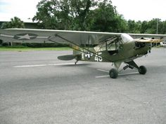 Army Air Corps L4 Piper Cub. From the back seat, you fly solo, or with a pilot in the front seat, an Observer can fax backwards and write on the table behind him.  How would you like to fly a cloth covered airplane with a wooden wing structure over enemy territory?
