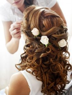 Hairdress of the bride decorated with flowers Stock Photo - 15502228