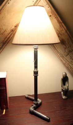 Cool Pipe Lamp. Here are some other styles: http://www.etsy.com/shop/IndustrialistDesigns?ref=seller_info