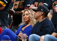 Stunner: Beyonce made the clever decision to offset her cobalt suit with a red lip