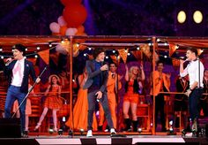 Zayn Malik Harry Styles and Liam Payne performing at the Closing Ceremony of the Olympics