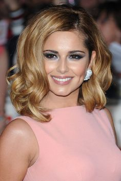 Cheryl Cole. Wrong hair color, the peach is too warm for a soft winter type.