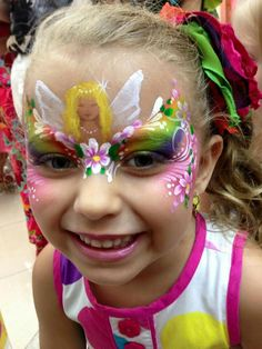 Beautiful rainbow flowers face painting for girls by Jasmine Walsh