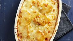 Earthy rutabagas and aged Gruyere add intrigue to a classic potato gratin. Slicing the root vegetables with a mandoline and cooking the ingredients on the stove top before baking results in an especially luscious dish.
