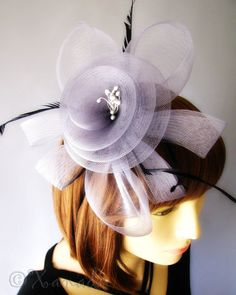 Large Grey Fascinator Hairband Accessory With Mesh Flower And Black Feather Embellishments - Great For Weddings. $34.95, via Etsy.