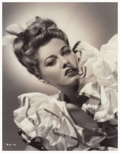 Ramsay AMES '40-50 (30 Mars 1919 - 30 Mars 1998)was a leading 1940s American B movie actress,[1][2] model, dancer,[3] comediene, pin-up girl and host of a television show. She was also the star of the The Mummy's Ghost (1944), where she played the Princess Ananka.  She was married to and later divorced Dale Wasserman, award-winning musical writer.  She died of lung cancer.