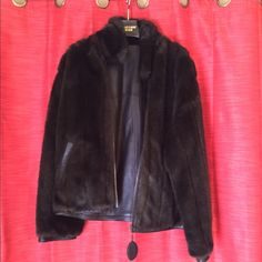 Sale!Faux Fur, real Leather 'Reversible' Coat! Dark chocolate(almost looks black); like new Reversible Faux Fur, yet Genuine Leather 'Wilson's Leather'Coat. Never worn, because coat was a gift and is way too big. It is a size Medium but fits like an XL; the sleeves run pretty long, fits for a woman in between the sizes of 16/18. This reversible faux fur/ 'genuine' leather coat will be a fabulous addition to your closet this year! Pelle Studio Wilson Leather Jackets & Coats