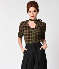 For the ladylike troublemaker! Brand new from Voodoo Vixen in pure retro grunge radiance, the Mavis top is a vintage style blouse in a soft green plaid poly knit. Paneled darting creates a fitted form and side darting with sweet button cuff half sleeves e