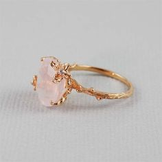 Unique Rose Quartz Ring by 4FireflyCollections on Etsy...Someone recently stole my wallet while my family and I were on vacation and I had my wedding band and 2 carat diamond engagement ring zipped up in them. That diamond ring was really expensive but I'd be happy with a $80.00 ring like this as a replacement. it's so pretty and delicate,