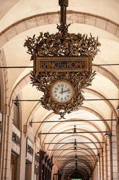 A large clock of Banco di Roma in one of Bologna's arcades - Bologna, Emilia-Romagna, Italy - www.rossiwrites.com