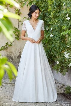 Perfectly timeless, this classic lace wedding dress captivates with its understated elegance. Simple, harmonious lines accentuate the dainty lace pattern, which continues into the dramatic V-neckline as scalloped edging. Feminine and flattering, this is a pretty lace gown to be remembered by.
