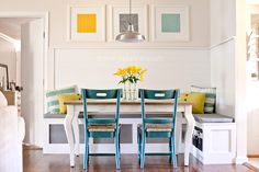 pretty DIY banquette. I'm pinning for the colorful chairs with white table/stained top.