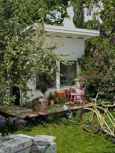 garden shed with bushes disguising it - good idea to consider blocking with plants in planning