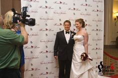 We designed this Red Carpet themed wedding complete with Step & Repeat wall and Paparazzi!  www.SightNSound.com