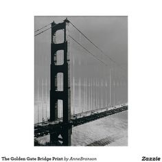 Golden Gate Bridge Photo Print. This award-winning photograph of San Francisco's famous bridge was developed as a Sabattier black and white, silver gelatin print. Sabattier is a solarization process whereby the photo paper is re-exposed during development. The result is a unique - often mysterious looking - silver image which contains light lines between the shadows and the highlighted areas. This effect can be seen on both the bridge and the bay, as well as around the cars driving through.