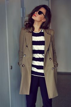 Stripes, trench, coral lipstick.