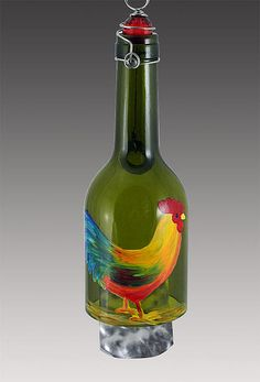 This colorful rooster will transform wind into beautiful music. This design now features cute chicks at his side.