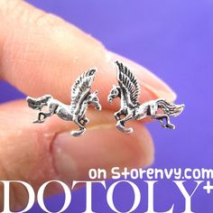 This is a listing for a pair of unicorn horse pony animal stud earrings in silver with sterling silver post and earring backs.   Each one measures 1 cm wide. ---  Sizing:   - All ring sizes refer to US Women sizes.  - You can find our size chart in our stores FAQ page   Handling t...