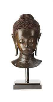 A North Thai, Ayutthaya period head of Buddha Shakyamuni  17th Century  Cast with his hair in tight curls, topknot, elongated earlobes, whis face with serene expression, mounted on stand 37 cm. high