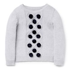 100% Cotton Knit. Fully fashioned knit sweater. Features cable knit panel on front with applique bobbles. Regular fitting silhouette. Available in colour shown.