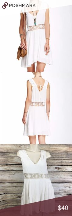 """Free People Summer Feeling white fit flare dress M Free People """"Feeling Summer"""" fit and flare dress, Mini above the knee style. 100% Rayon, but feels lightweight like a Linen dress, built in Slip. Sleeveless with an open back, size Medium, chest 34"""" length 35"""" In excellent pre owned condition! Free People Dresses Mini"""