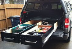 Picture of TRUCK BED DRAWERS...this is such a great idea.  If only we still had our pick-up with canopy!!