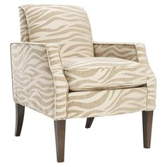 Add a pop of visual interest to your living room or master suite with this upholstered arm chair, showcasing a chic zebra-print motif and tapered wood legs. ...