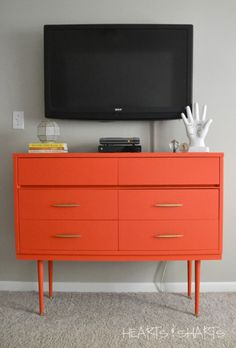 But a bright coat of coral paint and stylish, midcentury legs gave it new life. The new-and-improved media center now sits under a TV and is handy for storing appliances and DVDs.