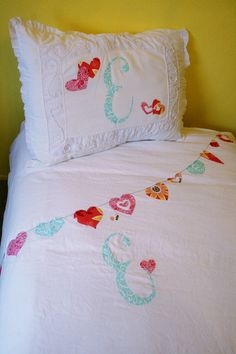 Appliqued Bedding with monogram and heart garland for a girl's room - from www.mybeautifulmessblog.com
