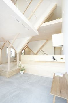 bright modern interior with concrete floors and wooden beams / columns loft apartment White Home