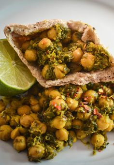 Urvashi shares one of the fastest ways to make a quick chickpea and spinach curry. Using canned and frozen veg, this easy vegetable curry recipe will be ready in as little as fifteen minutes. Chickpea Recipes, Veggie Recipes, Indian Food Recipes, Asian Recipes, Vegetarian Recipes, Cooking Recipes, Healthy Recipes, Cooking Time, Vegetarian Curry
