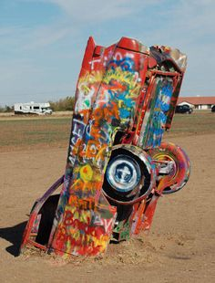 Scary Things On Route 66 | Roadside attraction picture: Cadillac Ranch car partially buried in ...