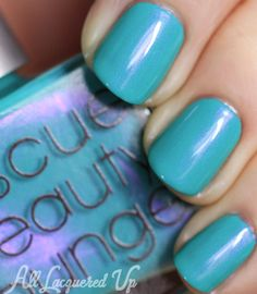 Rescue Beauty Lounge Aqua Lilly is a turquoise nail polish, vivid and bright with this shock of hot pink shimmer that illuminates the color.